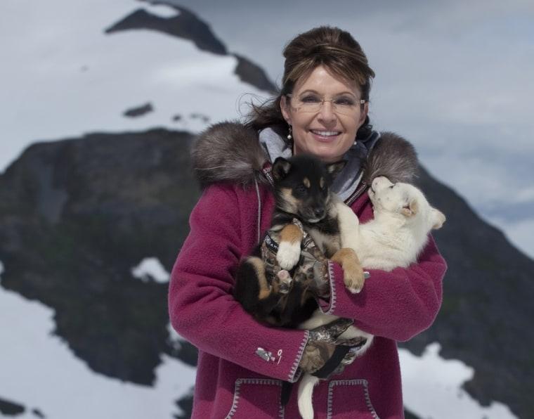 Sarah Palin snuggles with puppies on Alaska's Punch Bowl Glacier.