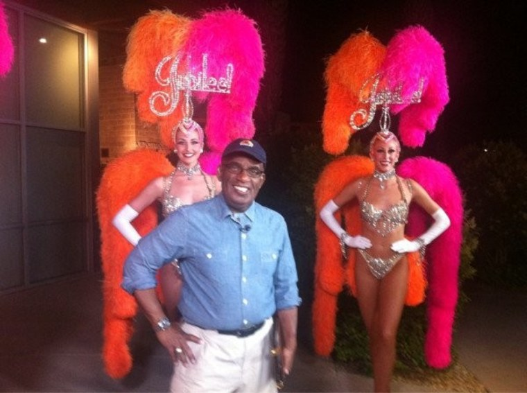 """Roughing it! Al broadcasts his Weather Channel program, \""""Wake Up With Al,\"""" with dancers from the longest running show in Las Vegas, Jubilee at Bally's."""