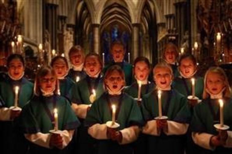 These members of the Salisbury (England) Cathedral Choir, shown practicing for Christmas Eve services, have likely caused some chills.