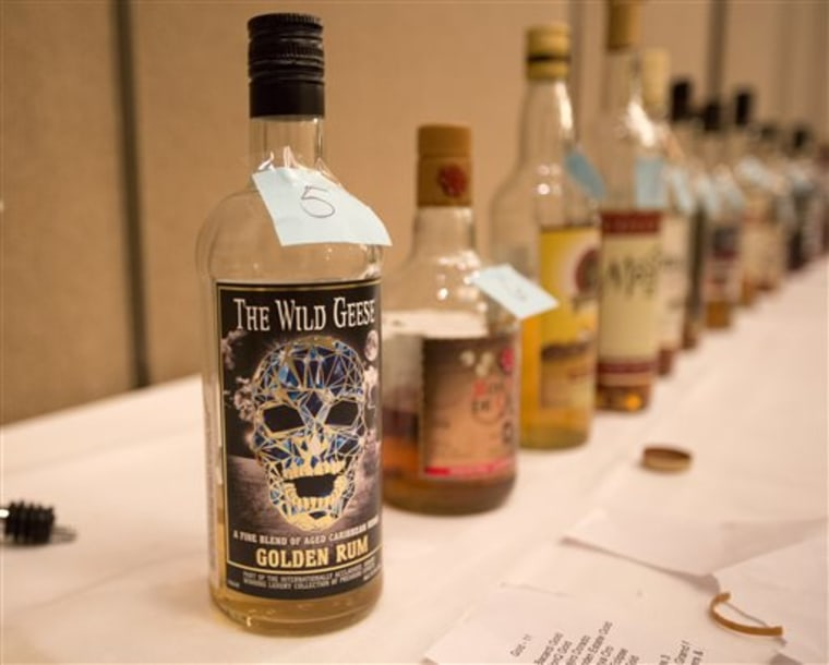 Bottles of rum are numbered Wednesday for judging during a tasting session at the Miami Rum Festival.
