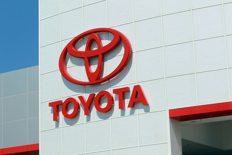 In this file photo, a Toyota service sign hangs on the exterior wall of a Toyota dealership on October 21, 2010 in Miami, Florida.