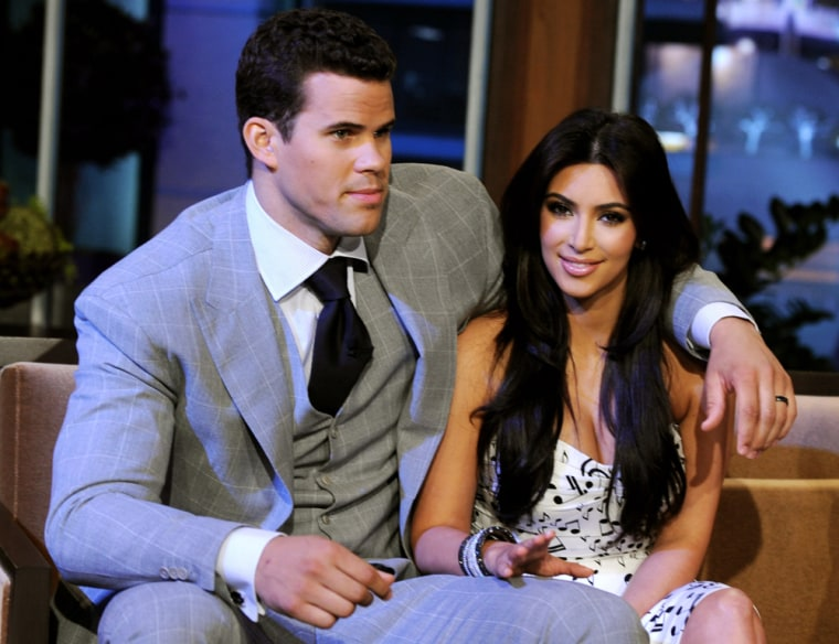 Kris Humphries and Kim Kardashian, seen here in 2011, have reached a divorce settlement.