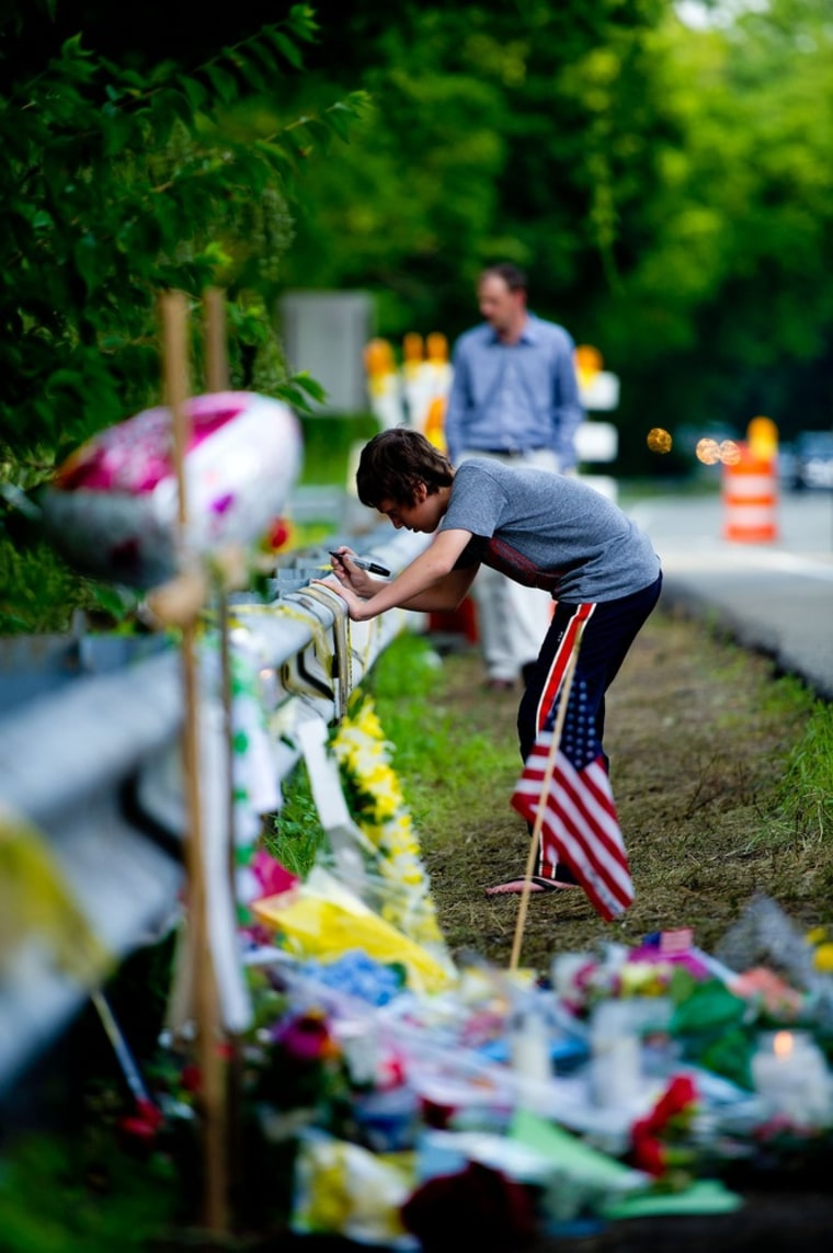 Mourners pay tribute last week at the fatal crash scene where Ryan Dunn and passenger Zachary Hartwell were killed in West Chester, Pa.