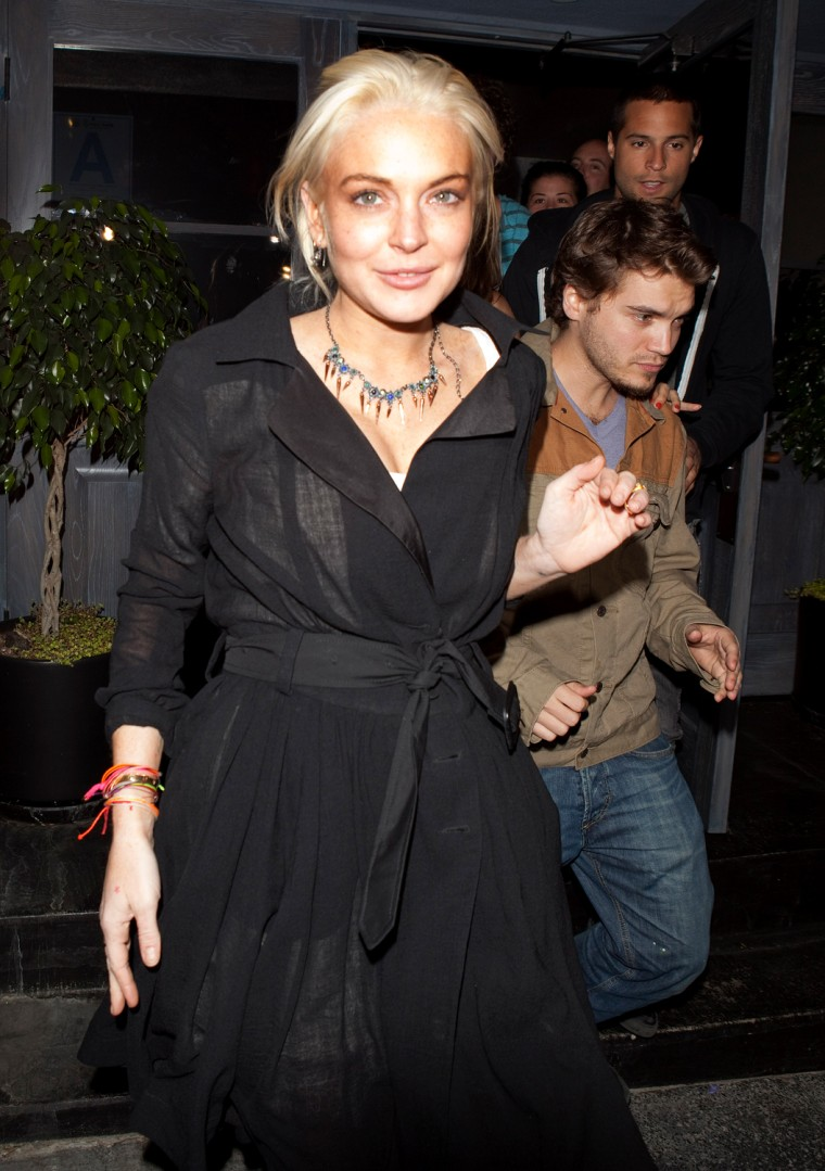 Lindsay Lohan and actor Emile Hirsch, right, are seen leaving the Lexington Social Club in Hollywood, calif., on Wednesday.