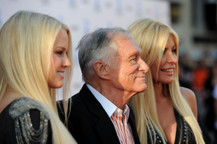Hugh Hefner is flanked by Miss January Anna Sophia Berglund, left, and Crystal Harris at a film premiere in Hollywood on April 28.