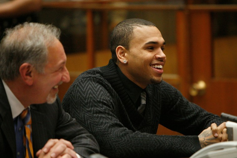 R&B singer Chris Brown, right, appears in court with his attorney Mark Geragos for a probation progress report hearing in Los Angeles on Jan. 28.