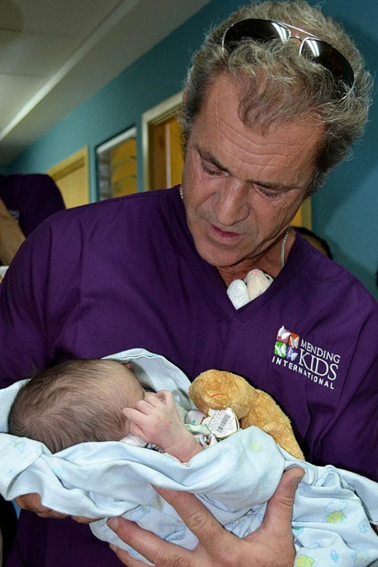 Mel Gibson holds a baby during a visit to the pediatrics ward of the Hospital General San Juan de Dios in Guatemala City, Guatemala, on Wednesday.