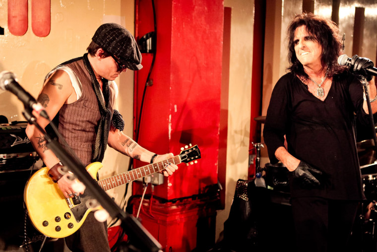 Johnny Depp and Alice Cooper perform together on stage at the 100 Club in London on Sunday, June 26.