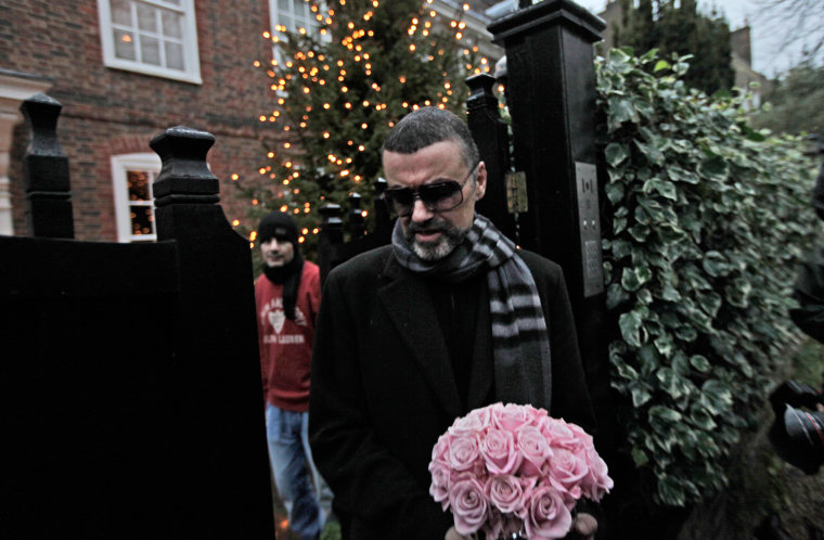 British singer George Michael leaves his house in north London, Friday, Dec. 23, 2011. George Michael, short of breath and appearing weak, said Friday he has recovered from a life-threatening bout with pneumonia that kept him in a Vienna hospital for a month.