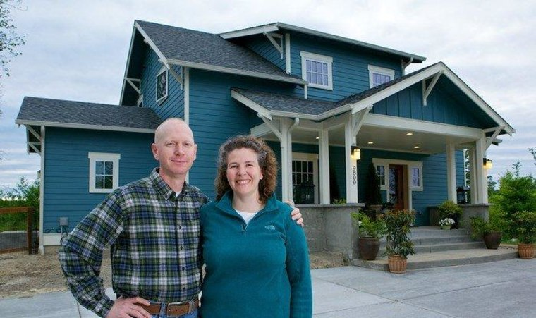 Matt Cooper and Eileen Ryan paid a premium for their new energy-efficient home in Olympia, Wash. But they pay almost nothing in energy bills.