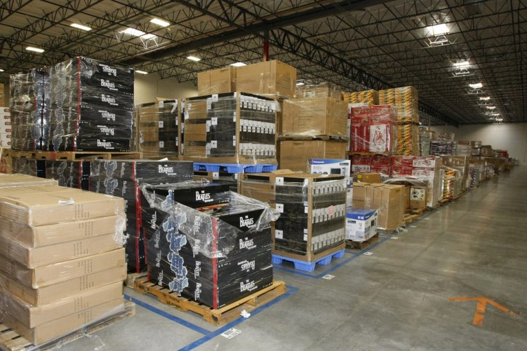 Merchandise sits at the Amazon Phoenix Fulfillment Center in Goodyear, Arizona in this November 16, 2009 file photograph. Amazon has throw its weight ...