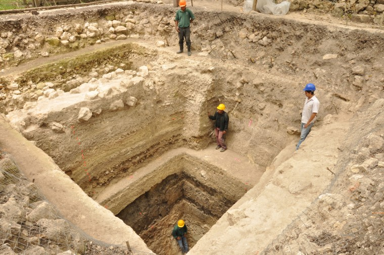 Workers stand on Platform A-24 at the Ceibal archaeological site in Guatemala. Archaeologists say the dig revealed the oldest monumental construction in the Maya lowlands.