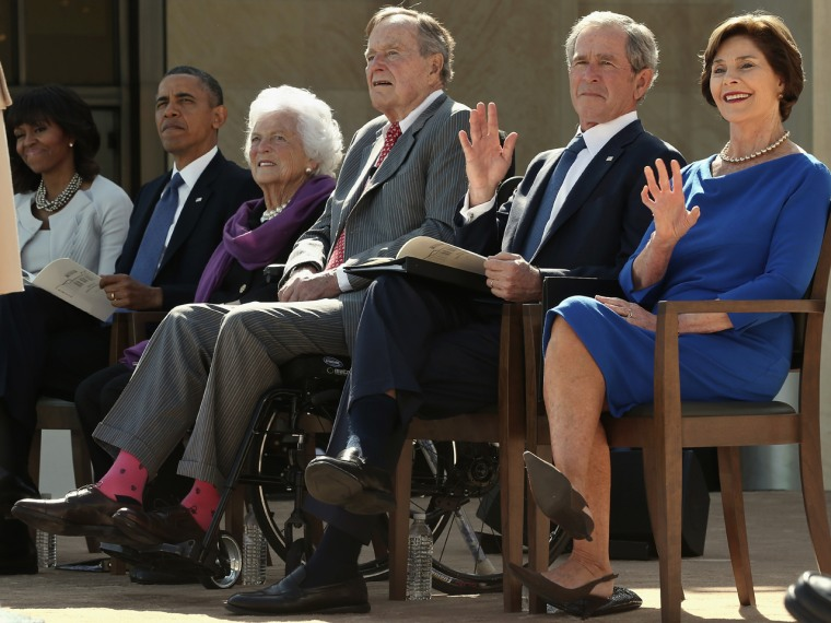 Former President George H.W. Bush broke out his trademark colored socks for the ceremony dedicating the presidential library of his son, former President George W. Bush, on Thursday. He appeared alongside First Lady Michelle Obama, President Barack Obama, wife Barbara Bush, and Laura and George W. Bush.