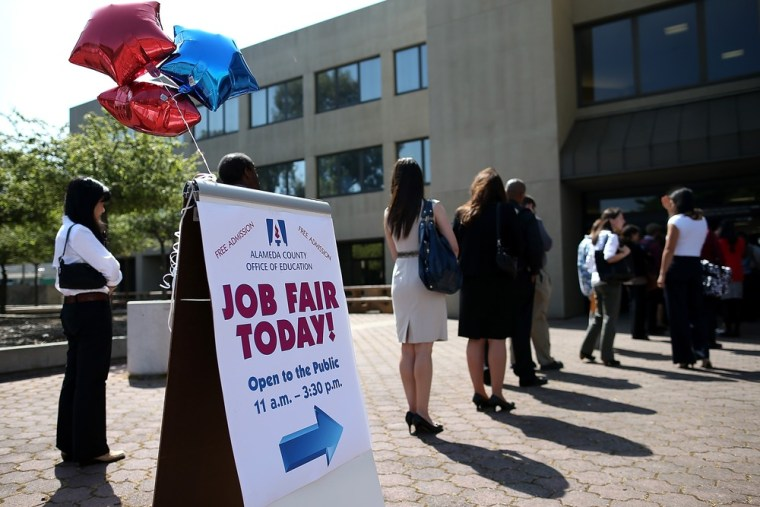 Job seekers line up to enter a job fair at the Alameda County Office of Education on April 24, 2013 in Hayward, California.