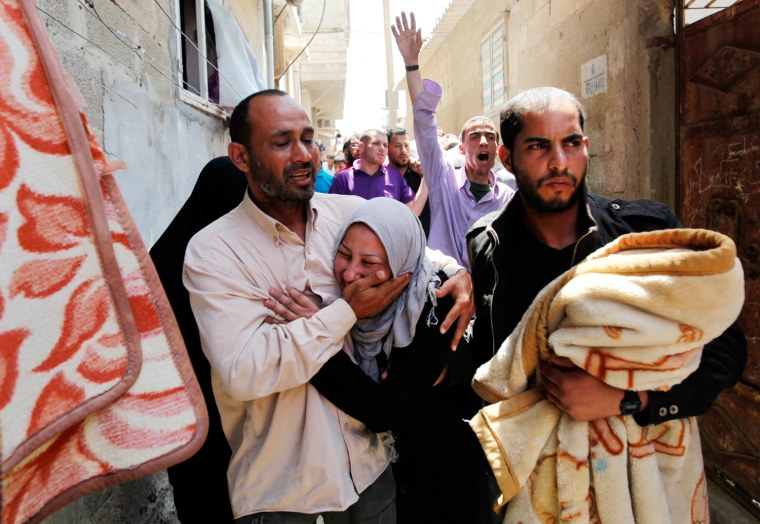 Relatives of a man killed by an Israeli airstrike mourn during his funeral Tuesday in the Shati Refugee Camp in Gaza City. Israel said the man, Hithem Masshal, was a