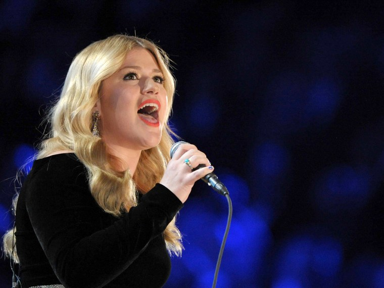 FILE - In this Sunday, Feb. 10, 2013 file photo, Kelly Clarkson performs on stage at the 55th annual Grammy Awards in Los Angeles. The British governm...