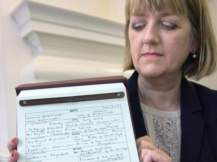 Westminster city council registrar Alison Cathcart holds a copy of the birth register of Prince George of Cambridge at Westminster Register Office in ...