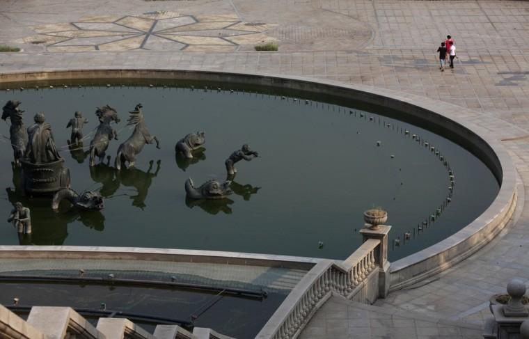People walk past a fountain at the Tianducheng development in Hangzhou Aug. 1.