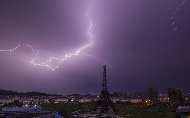 A lightning bolt streaks across the sky above a replica of the Eiffel Tower at the Tianducheng development in Hangzhou.