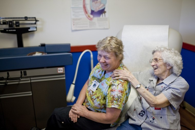 Nurse practitioner Mary Fey receives a back rub from her patient Willetta Crosby at the Dexter Clinic run by Peace Health, in Dexter., Or., on July 10...