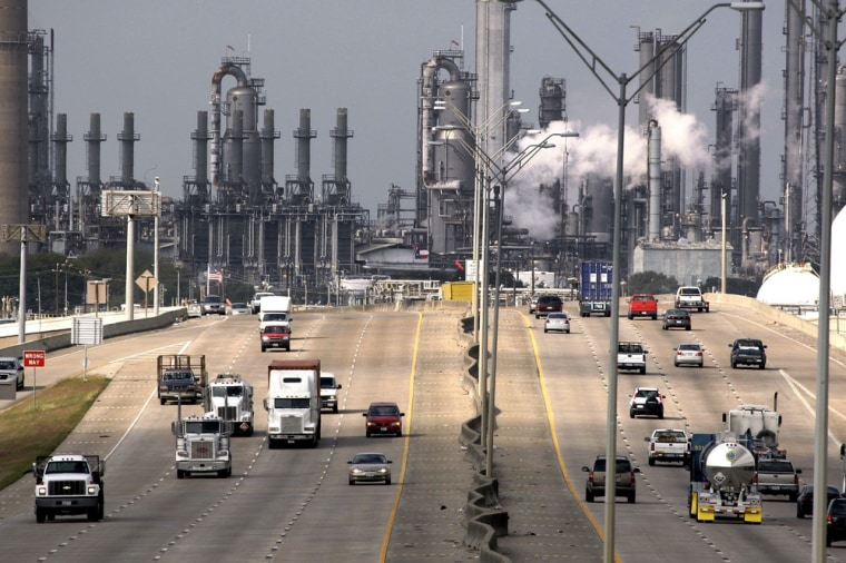 **FILE** In this Nov. 21, 2007 file photo, Shell Oil Company's Deer Park refinery and petrochemical facility is shown in the background as vehicles tr...