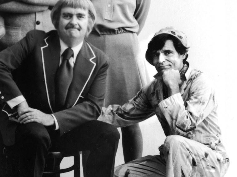 American children's television host Robert (Bob) Keeshan (C) (1927 - 2004) poses with the cast of his TV series, 'Captain Kangaroo,' 1975. L-R: Hugh B...