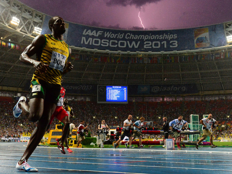 The world's fastest man, Jamaican Usain Bolt, had just cruised to victory in the 100-meter final at Sunday's world championships in Moscow when a lightning bolt flashed in the sky and was captured in a dramatic photo of a bolt for Bolt.