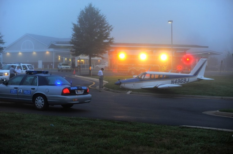 small plane crash lands at gas station after running out of fuel. Black Bedroom Furniture Sets. Home Design Ideas