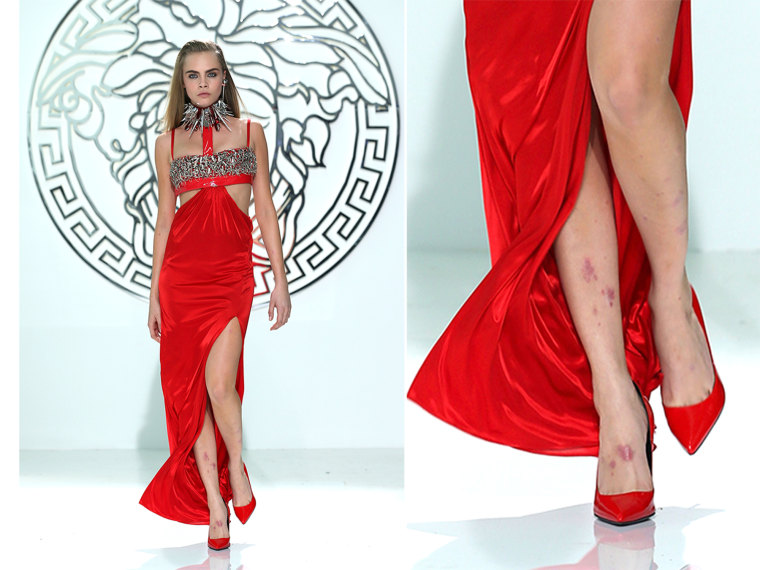 MILAN, ITALY - FEBRUARY 22:  Cara Delevingne walks the runway at the Versace fashion show during Milan Fashion Week Womenswear Fall/Winter 2013/14 on ...