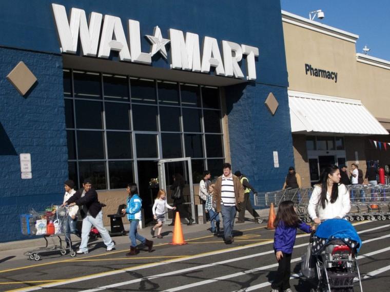 Customers walk outside a Walmart store in this November 17, 2012 file photo in Norwalk, Connecticut. US retail behemoth Walmart on June 7, 20...