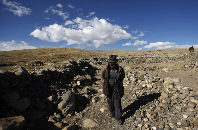 Carmelo Flores Laura, a native Aymara, walks near his home in the village of Frasquia, Bolivia, Tuesday, Aug. 13, 2013. If Bolivia's public records are correct, Flores is the oldest living person ever documented. They say he turned 123 a month ago. To what does the cattle and sheepherder owe his longevity?