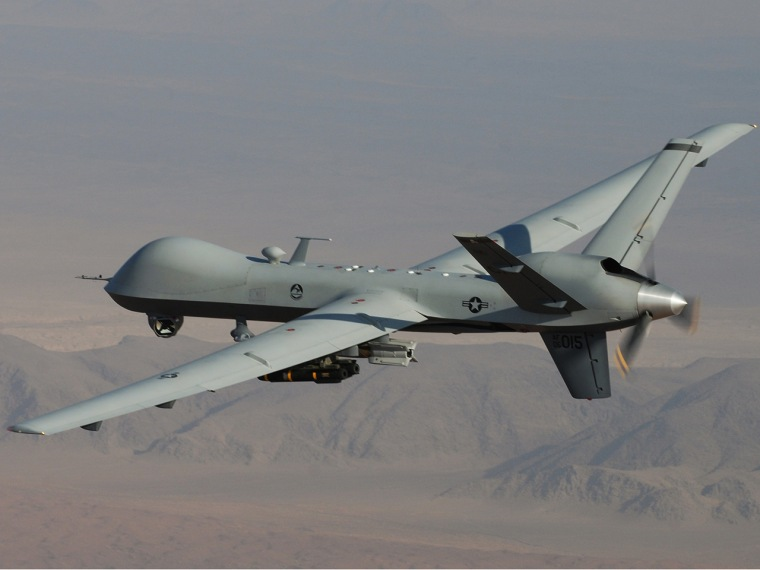 An MQ-9 Reaper, armed with GBU-12 Paveway II laser guided munitions and AGM-114 Hellfire missiles, flies over southern Afghanistan in an undated photo.