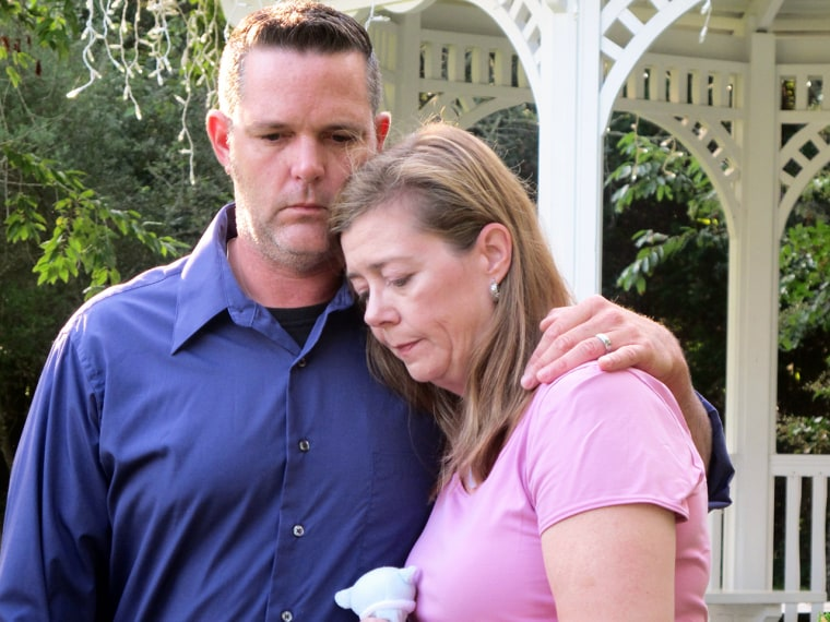 Melanie and Matt Capobianco stand side by side before a news conference on James Island, S.C., on Monday, Aug. 12, 2013. The couple, who are trying to...