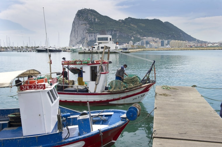 Spanish fishing boats sit moored in La Linea de Concepcion, Spain, in front of Gibraltar on May 28, 2012.