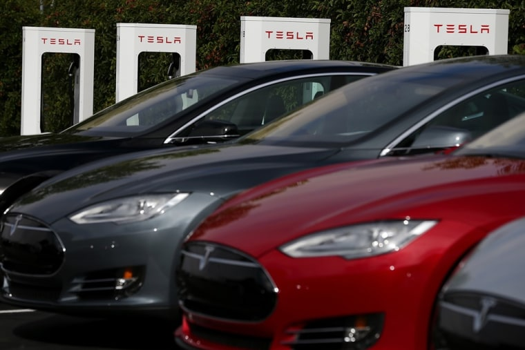 Tesla Model S sedans are seen parked in front of a row of new Tesla Superchargers outside of the Tesla Factory on August 16, 2013 in Fremont, Californ...