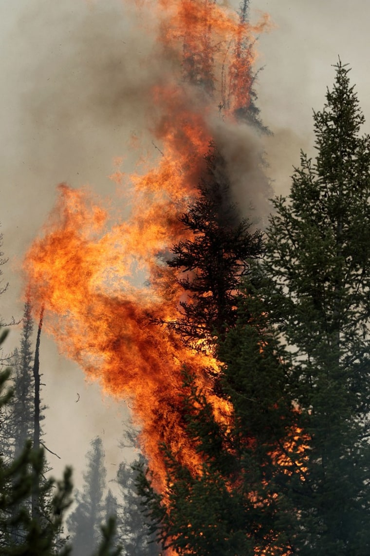 In this Monday, Aug. 19, 2013 photo, the 104,457-acre Beaver Creek Fire burns in the Baker Creek area, north of Ketchum, Idaho. (AP Photo/Times-News, Ashley Smith)