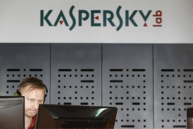 An employee works near screens in the virus lab at the headquarters of Russian cyber security company Kaspersky Labs in Moscow July 29, 2013. REUTERS/...