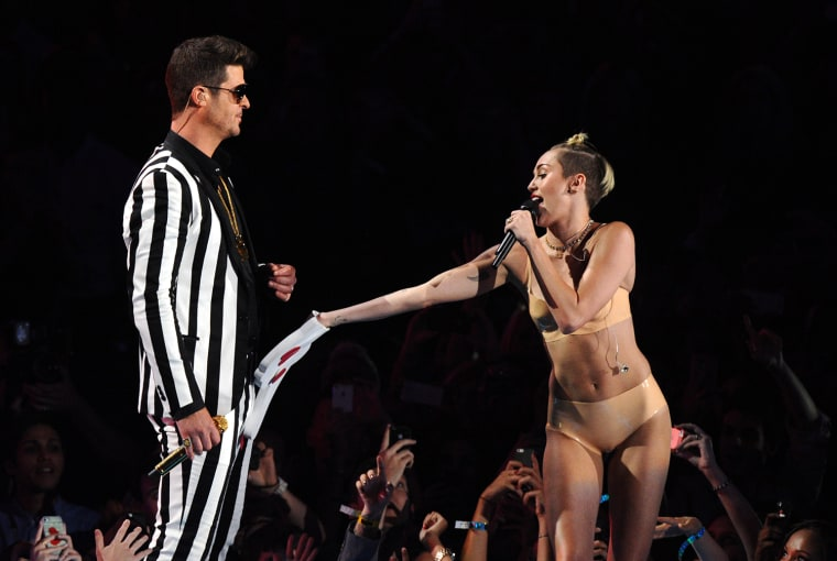 "Robin Thicke, left, and Miley Cyrus perform ""Blurred Lines"" at the MTV Video Music Awards on Sunday, Aug. 25, 2013, at the Barclays Center in the Broo..."