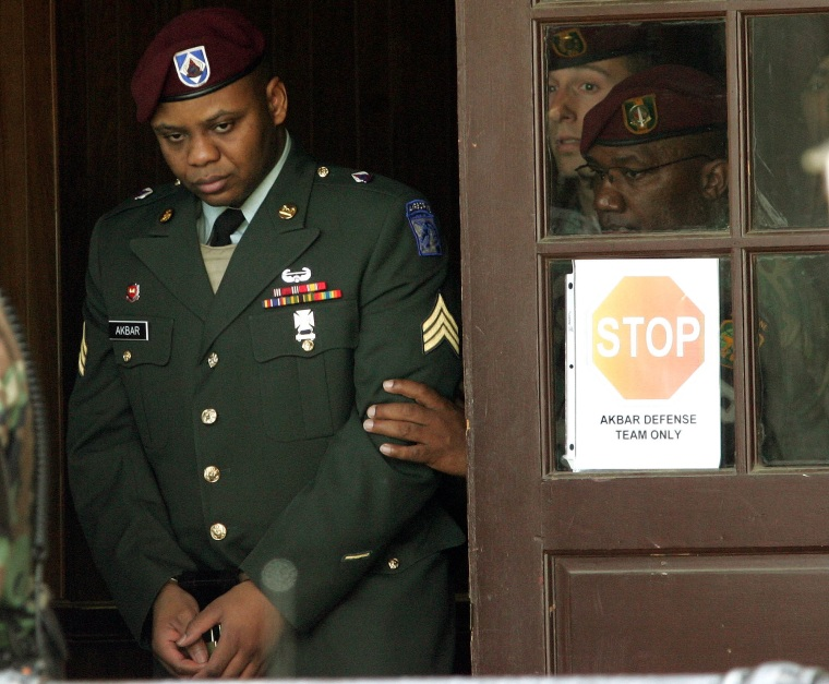 Sgt. Hasan Akbar, left, is led from the Staff Judge Advocate Building at Fort Bragg, N.C., in April 2005, during the sentencing phase of his court-martial.