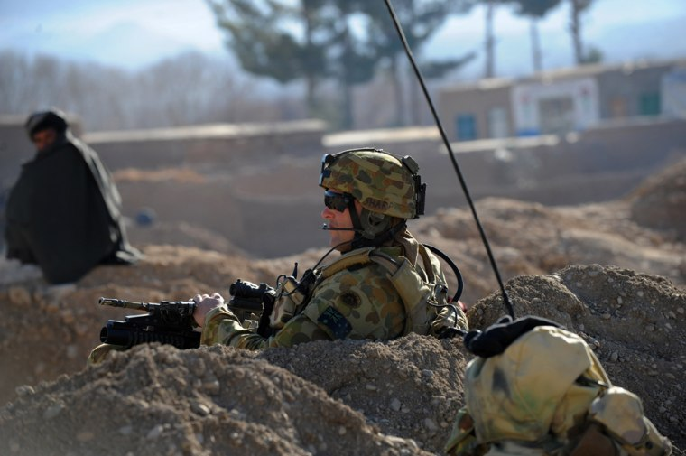 An Australian soldier of Omlet-c company takes position during a NATO/ISAF joint task force patrol in Afghanistan's Uruzgan province in 2010.