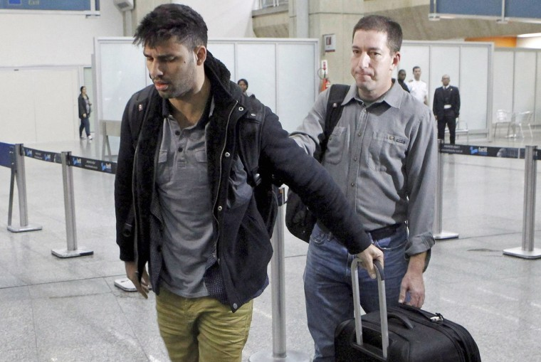 David Miranda (L) -- the Brazilian partner of Glenn Greenwald, a US journalist with Britain's Guardian newspaper who worked with intelligence leaker Edward Snowden to expose US mass surveillance programmes -- is pictured at Rio de Janeiro's Tom Jobim international airport upon his arrival on August 19, 2013.