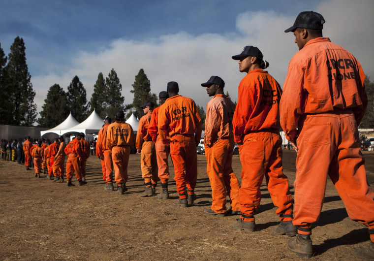 Inmate firefighters line up for dinner at the Rim Fire camp near Buck Meadows, Calif.