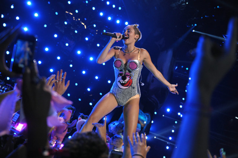 This image released by MTV shows Miley Cyrus performing at the MTV Video Music Awards at Barclays Center on Sunday, Aug. 25, 2013, in the Brooklyn bor...