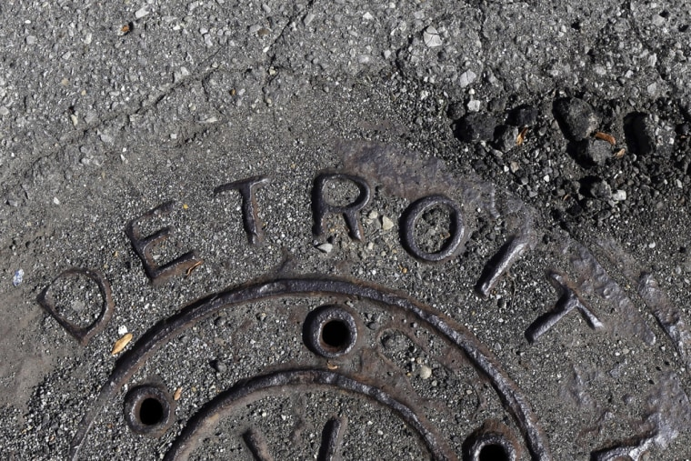 Detroit is eligible to proceed with the largest municipal bankruptcy ever, a judge rules.