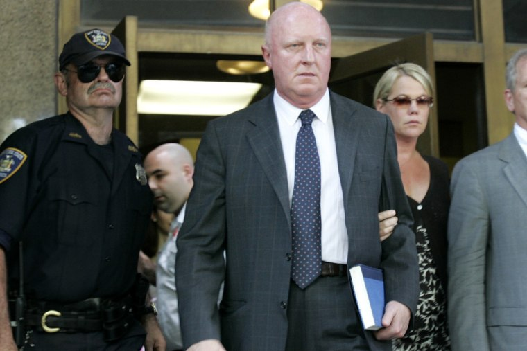 Former Tyco CEO Dennis Kozlowski, center, leaves court with his wife, Karen, right, in New York, Friday, June 17, 2005.