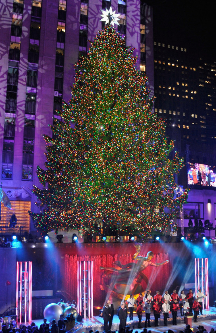 the christmas tree is lit during 81st annual rockefeller center christmas tree lighting ceremony at rockefeller