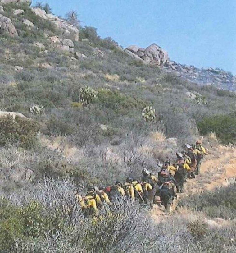 Members of the Granite Mountain Interagency Hotshot Crew are shown hiking up Yarnell Hill the morning of June 30, the day they were overcome by the fire, in a photo released as part of the Arizona Industrial Commission's investigation Wednesday.