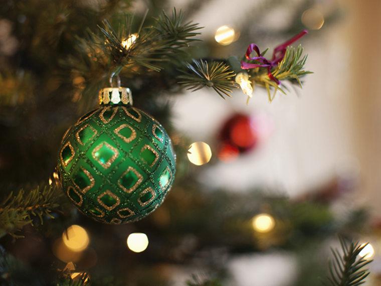 An ornament hangs on a Christmas tree.