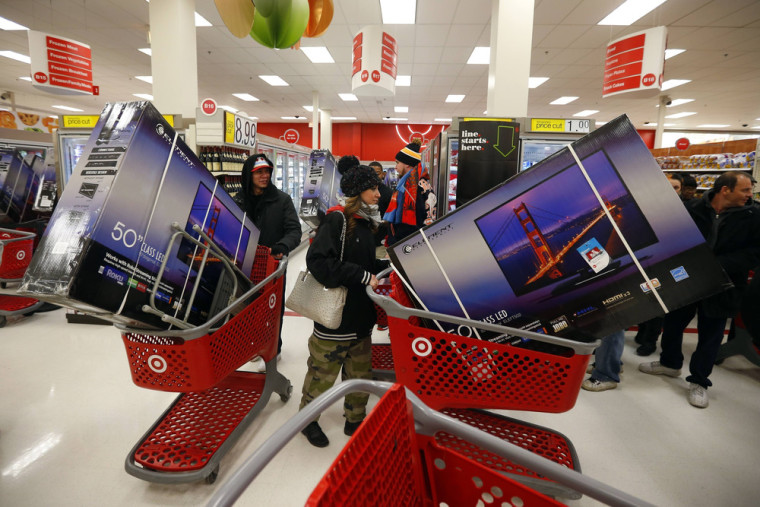 Thanksgiving Day holiday shoppers line up with televisions on discount at the Target retail store in Chicago, Illinois, November 28, 2013. About 140 m...