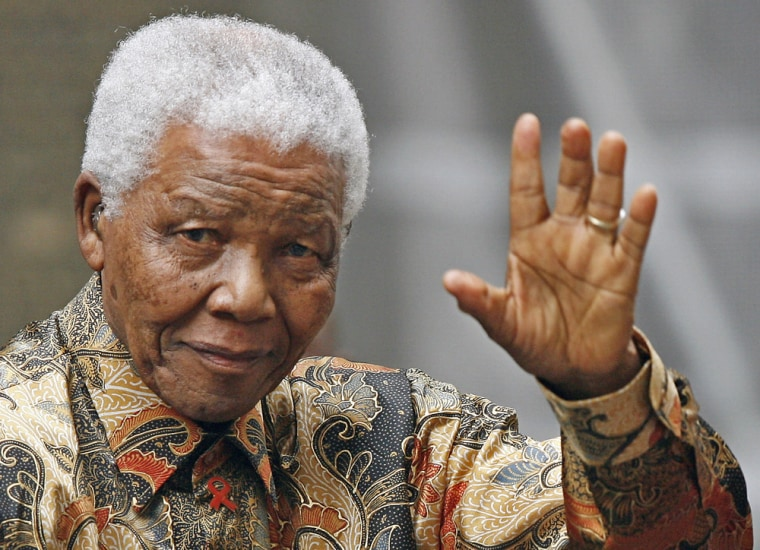 Former South African president Nelson Mandela waving to the media as he arrived outside 10 Downing Street, in central London, for a meeting with the British Prime Minister, on Aug. 28, 2007.